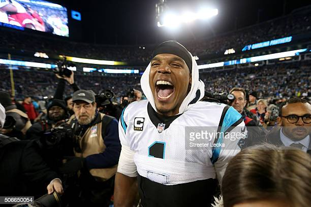 Cam Newton of the Carolina Panthers celebrates after the Carolina Panthers defeat the Arizona Cardinals with a score of 49 to 15 in the NFC...