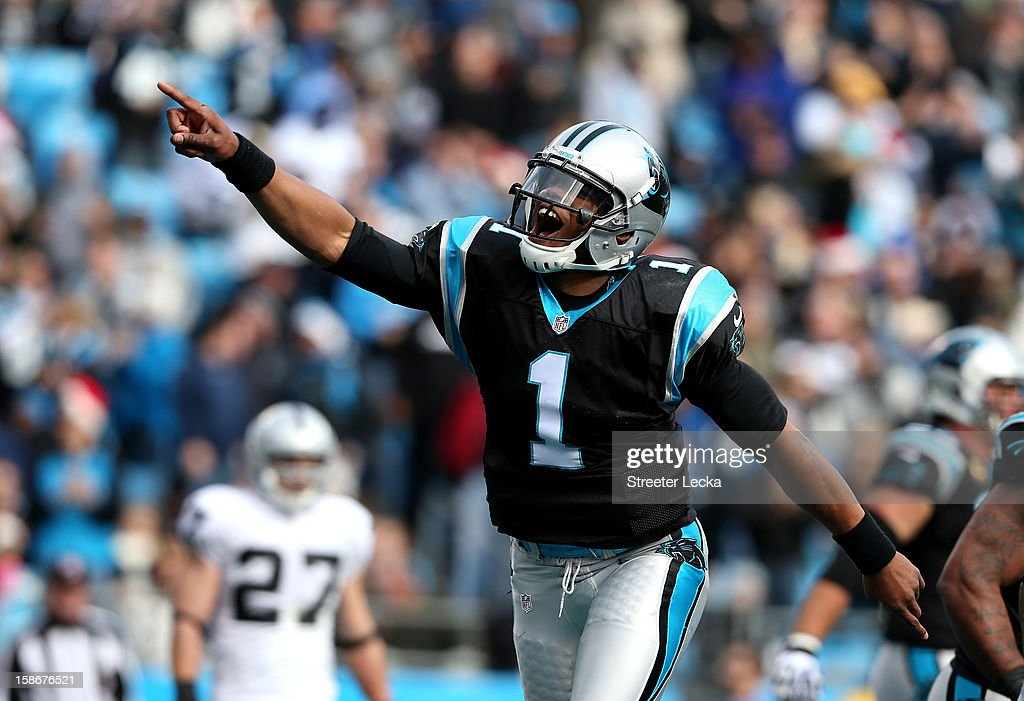 Cam Newton #1 of the Carolina Panthers celebrates after throwing a touchdown pass to teammate Steve Smith #89 during their game against the Oakland Raiders at Bank of America Stadium on December 23, 2012 in Charlotte, North Carolina.