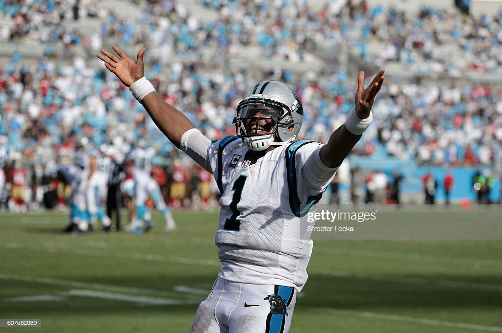 Cam Newton #1 of the Carolina Panthers celebrates after throwing a touchdown pass against the San Francisco 49ers during their game at Bank of America Stadium on September 18, 2016 in Charlotte, North Carolina.