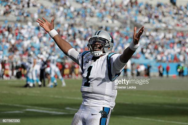 Cam Newton of the Carolina Panthers celebrates after throwing a touchdown pass against the San Francisco 49ers during their game at Bank of America...