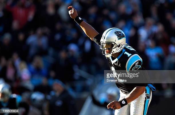 Cam Newton of the Carolina Panthers celebrates after throwing a touchdown against the Atlanta Falcons during their game at Bank of America Stadium on...