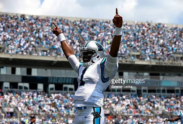 Cam Newton of the Carolina Panthers celebrates after throwing a touchdown to Steve Smith against the Seattle Seahawks during their game at Bank of...