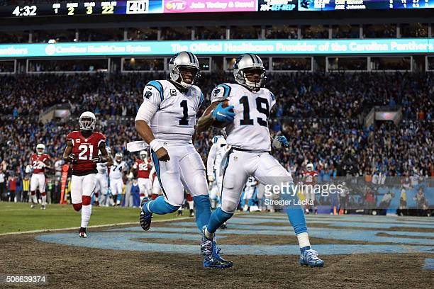 Cam Newton of the Carolina Panthers celebrates as Ted Ginn Jr. #19 scores a touchdown in the first quarter against the Arizona Cardinals during the...
