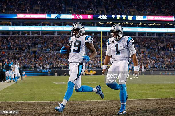 Cam Newton of the Carolina Panthers celebrates as Ted Ginn Jr #19 scores a touchdown in the first quarter against the Arizona Cardinals during the...