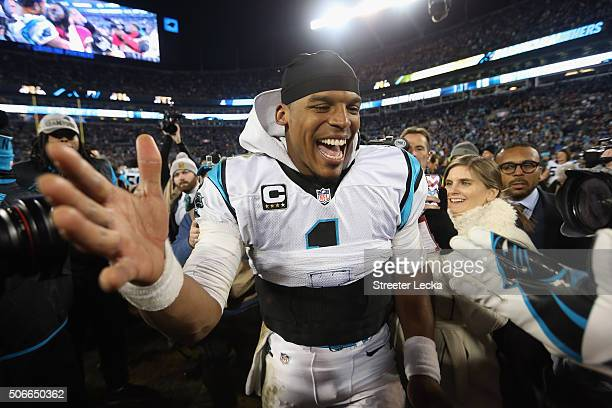 Cam Newton of the Carolina Panthers celebrates defeating the Arizona Cardinals with a score of 49 to 15 to win the NFC Championship Game at Bank of...