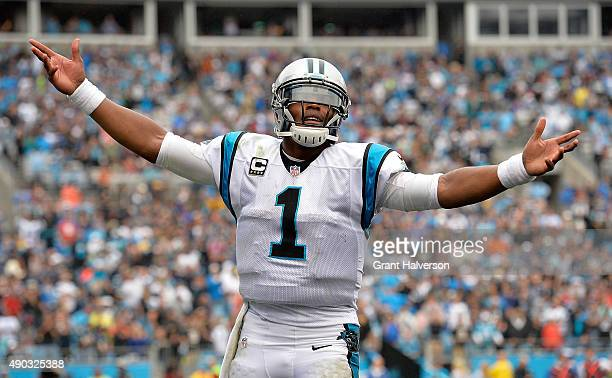 Cam Newton of the Carolina Panthers celebrates his fourth quarter touchdown rush against the New Orleans Saints during their game at Bank of America...