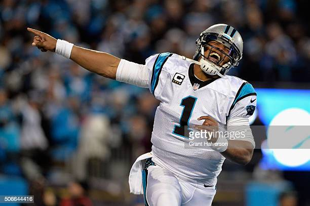 Cam Newton of the Carolina Panthers celebrates scoring a touchdown in the second quarter against the Arizona Cardinals during the NFC Championship...