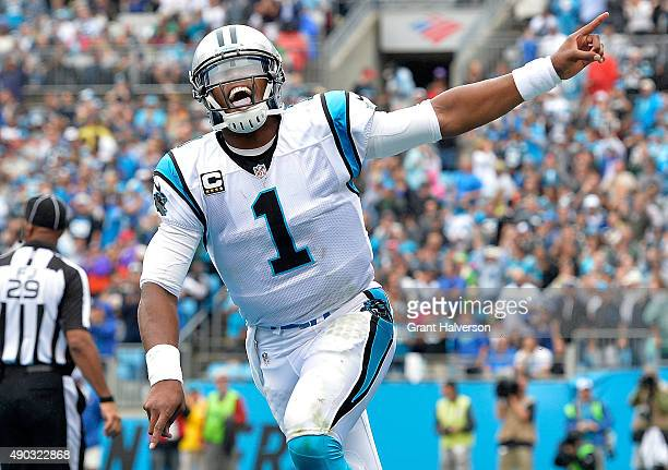 Cam Newton of the Carolina Panthers celebrates their second quarter touchdown against the New Orleans Saints during their game at Bank of America...
