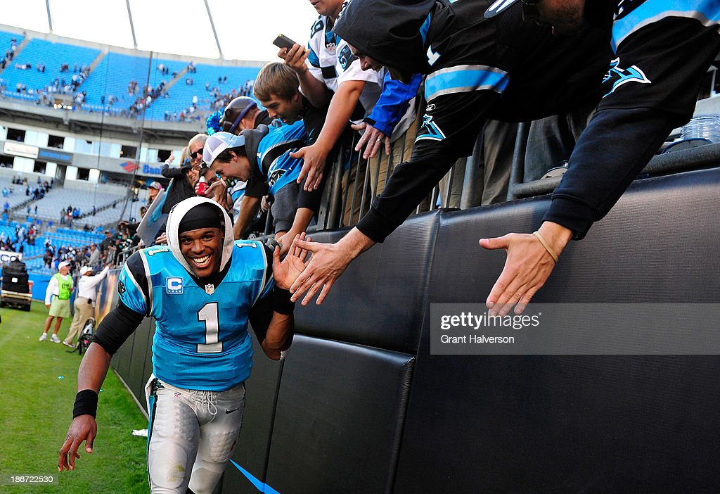Cam Newton #1 of the Carolina Panthers celebrates with fans after a win over the Atlanta Falcons at Bank of America Stadium on November 3, 2013 in Charlotte, North Carolina. The Panthers won 34-10.