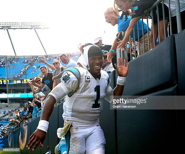 Cam Newton of the Carolina Panthers celebrates with fans after a win against the Houston Texans at Bank of America Stadium on September 20, 2015 in...