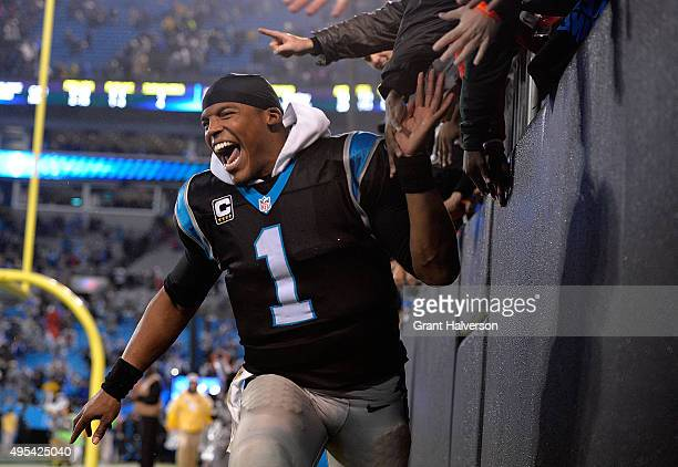 Cam Newton of the Carolina Panthers celebrates with fans after a win against the Indianapolis Colts at Bank of America Stadium on November 2 2015 in...