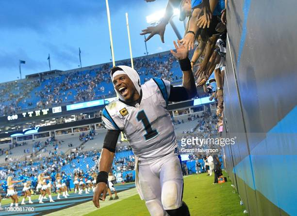 Cam Newton of the Carolina Panthers celebrates with fans after their win against the Dallas Cowboys at Bank of America Stadium on September 9 2018 in...