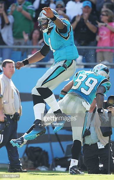 Cam Newton of the Carolina Panthers celebrates with Steve Smith after a second half touchdown during their game against the Washington Redskins at...
