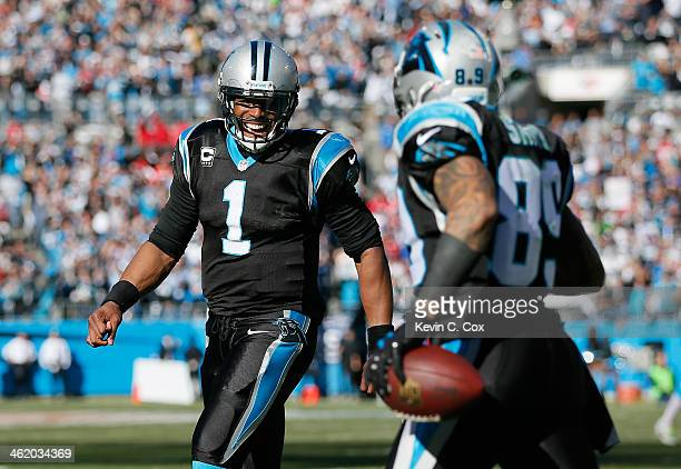 Cam Newton of the Carolina Panthers celebrates with Steve Smith after a touchdown in the second quarter against the San Francisco 49ers during the...