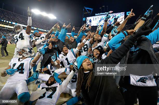 Cam Newton of the Carolina Panthers celebrates with teammates on the sideline in the fourth quarter against the Arizona Cardinals during the NFC...