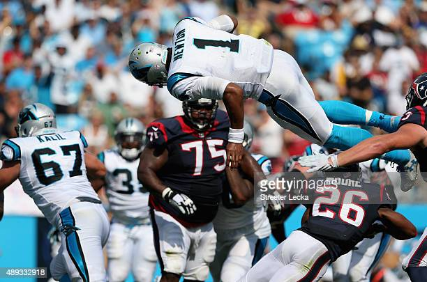 Cam Newton of the Carolina Panthers dives for a touchdown against the Houston Texans during their game at Bank of America Stadium on September 20...