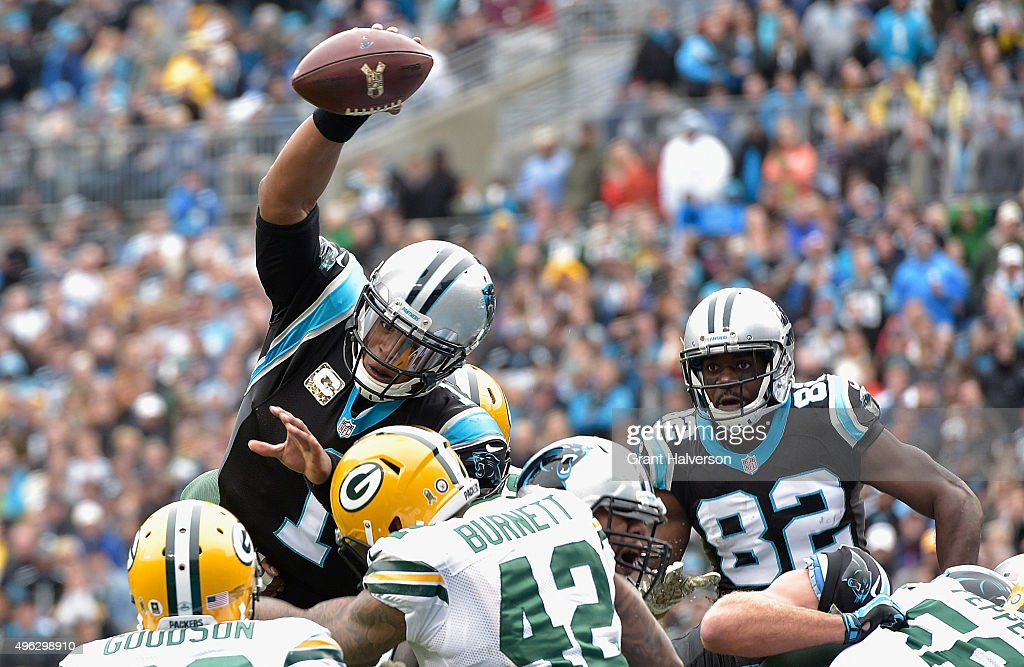Cam Newton #1 of the Carolina Panthers dives into the end zone for a touchdown during the second quarter of their game against the Green Bay Packers at Bank of America Stadium on November 8, 2015 in Charlotte, North Carolina.