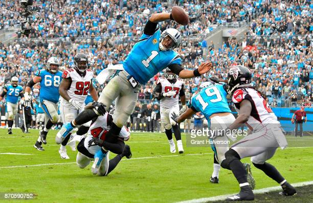 Cam Newton of the Carolina Panthers dives into the end zone for a touchdown during the second quarter of their game against the Atlanta Falcons at...
