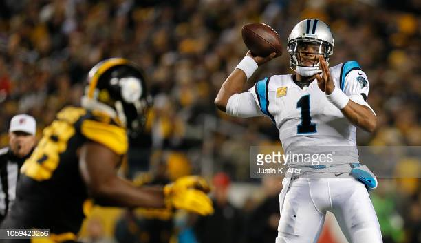 Cam Newton of the Carolina Panthers drops back to pass during the first half in the game against the Pittsburgh Steelers at Heinz Field on November 8...