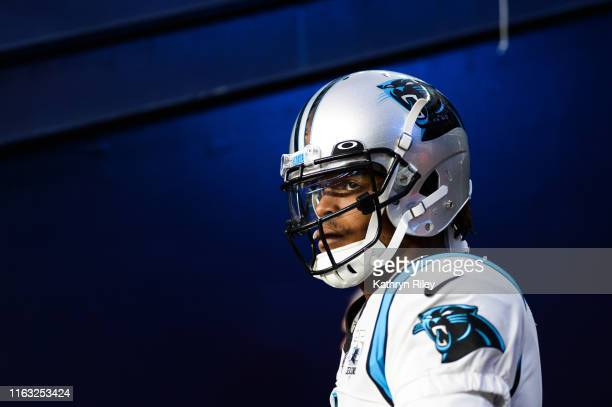 Cam Newton of the Carolina Panthers enters the field prior to the start of the preseason game against the New England Patriots at Gillette Stadium on...