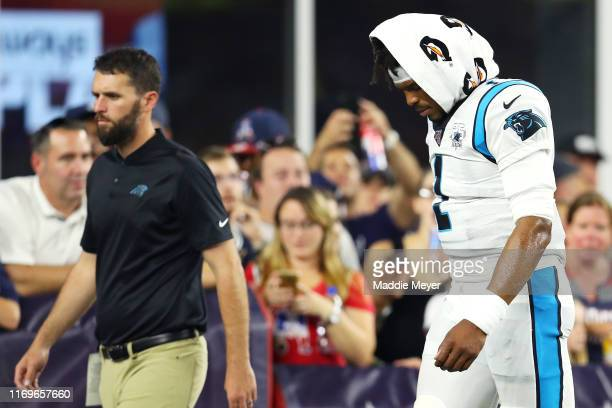 Cam Newton of the Carolina Panthers exits the field during the preseason game between the Carolina Panthers and the New England Patriots at Gillette...