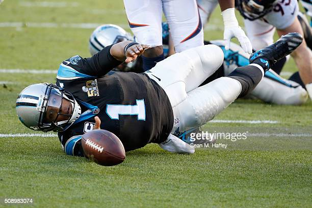 Cam Newton of the Carolina Panthers fumbles the ball in the first quarter of Super Bowl 50 at Levi's Stadium on February 7 2016 in Santa Clara...