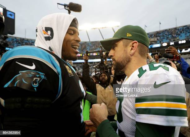 Cam Newton of the Carolina Panthers greets Aaron Rodgers of the Green Bay Packers after their game at Bank of America Stadium on December 17 2017 in...