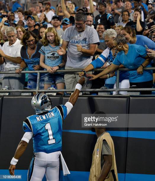 Cam Newton of the Carolina Panthers greets fans after a touchdown against the Miami Dolphins in the second quarter during the game at Bank of America...