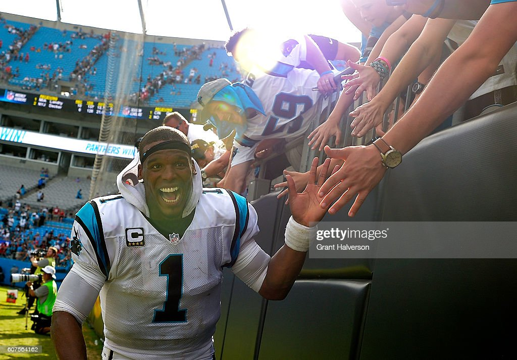Cam Newton #1 of the Carolina Panthers high fives fans after their 46-27 victory over the San Francisco 49ers at Bank of America Stadium on September 18, 2016 in Charlotte, North Carolina.