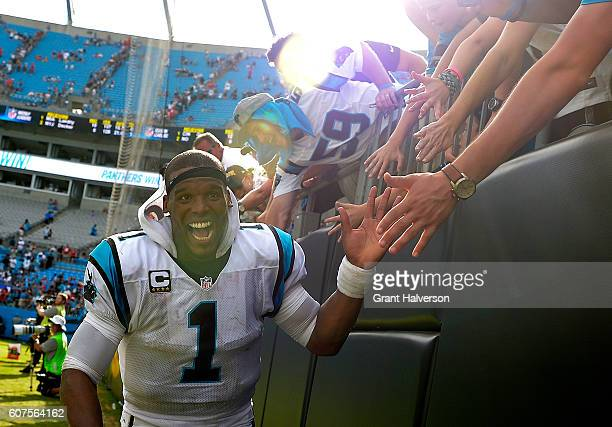 Cam Newton of the Carolina Panthers high fives fans after their 4627 victory over the San Francisco 49ers at Bank of America Stadium on September 18...