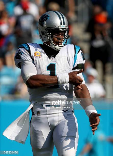 Cam Newton of the Carolina Panthers indicates the ice in his veins against the New York Giants in the fourth quarter during their game at Bank of...
