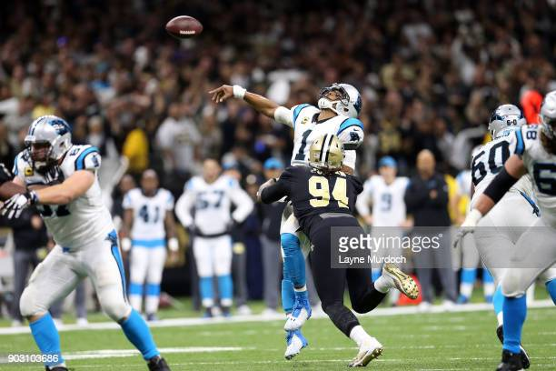 Cam Newton of the Carolina Panthers is called for intensional grounding as he is hit by Cameron Jordan of the New Orleans Saints during the second...