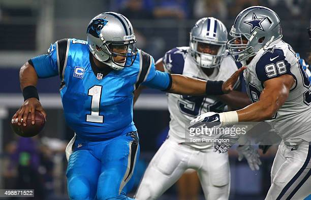 Cam Newton of the Carolina Panthers is chased by Tyrone Crawford of the Dallas Cowboys in the second half at AT&T Stadium on November 26, 2015 in...