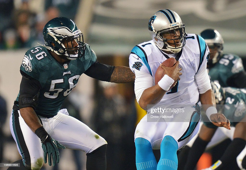 Cam Newton #1 of the Carolina Panthers is pressured by Akeem Jordan #56 of the Philadelphia Eagles at Lincoln Financial Field on November 26, 2012 in Philadelphia, Pennsylvania. The Panthers won 30-22.