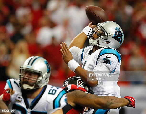 Cam Newton of the Carolina Panthers is pressured by Ra'Shede Hageman of the Atlanta Falcons at Georgia Dome on October 2 2016 in Atlanta Georgia