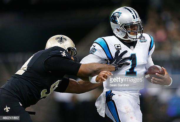 Cam Newton of the Carolina Panthers is pushed out of bounds by Cameron Jordan of the New Orleans Saints during a game at the MercedesBenz Superdome...