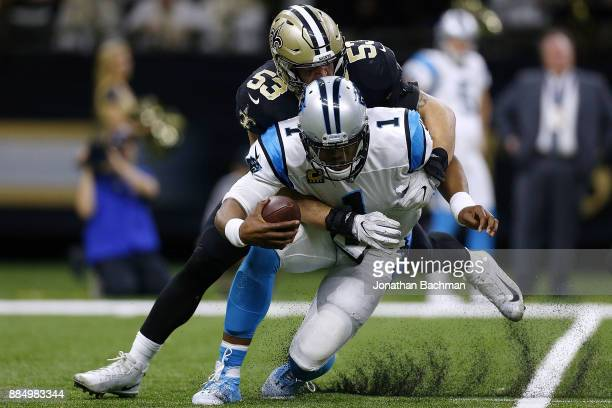 Cam Newton of the Carolina Panthers is sacked by AJ Klein of the New Orleans Saints during the second half of a game at the MercedesBenz Superdome on...