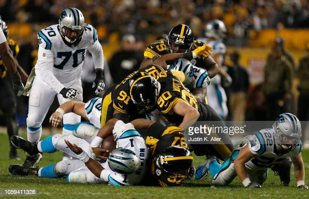 Cam Newton of the Carolina Panthers is sacked by Cameron Heyward of the Pittsburgh Steelers during the second half in the gae at Heinz Field on...