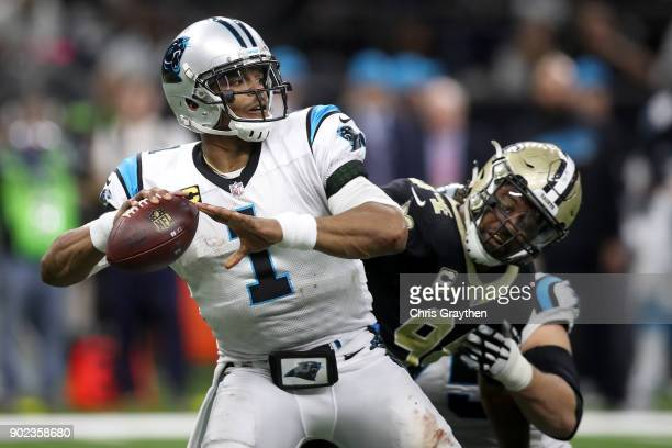 Cam Newton of the Carolina Panthers is sacked by Cameron Jordan of the New Orleans Saints at the MercedesBenz Superdome on January 7 2018 in New...