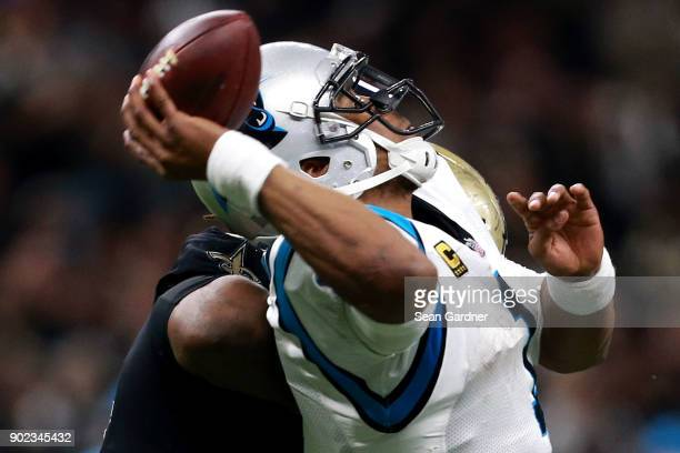 Cam Newton of the Carolina Panthers is sacked by David Onyemata of the New Orleans Saints during the second half of the NFC Wild Card playoff game at...