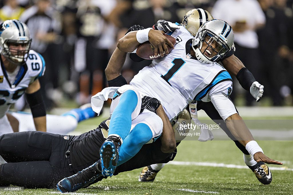 Cam Newton #1 of the Carolina Panthers is sacked during a game against the New Orleans Saints at Mercedes-Benz Superdome on December 8, 2013 in New Orleans, Louisiana. The Saints defeated the Panthers 31-13.