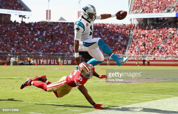 Cam Newton of the Carolina Panthers is tackled by Eric Reid of the San Francisco 49ers at Levi's Stadium on September 10 2017 in Santa Clara...