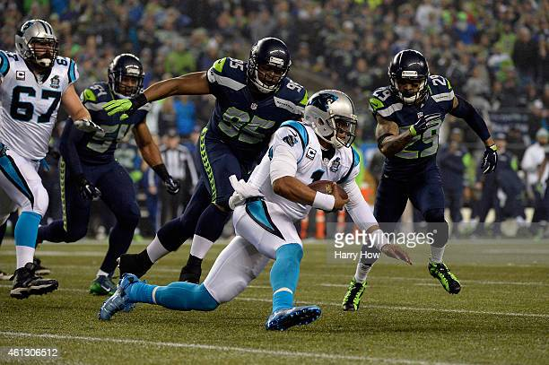 Cam Newton of the Carolina Panthers looks on against the Seattle Seahawks during the 2015 NFC Divisional Playoff game at CenturyLink Field on January...