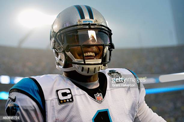 Cam Newton of the Carolina Panthers looks on during their NFC Wild Card Playoff game against the Arizona Cardinals at Bank of America Stadium on...