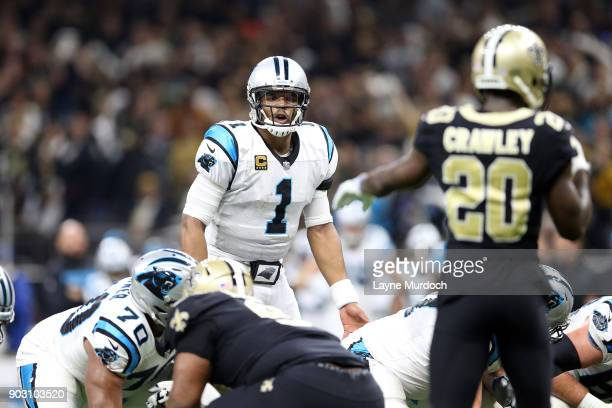 Cam Newton of the Carolina Panthers looks over the defense against Ken Crawley of the New Orleans Saints during the first half of the NFC Wild Card...