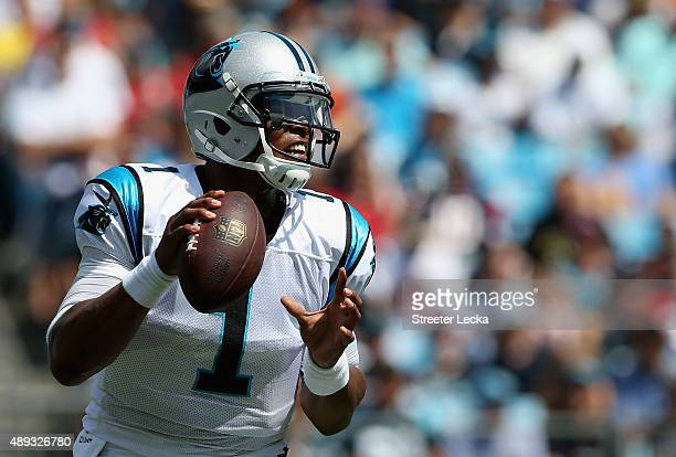 Cam Newton of the Carolina Panthers looks to pass against the Houston Texans in the first quarter during their game at Bank of America Stadium on...