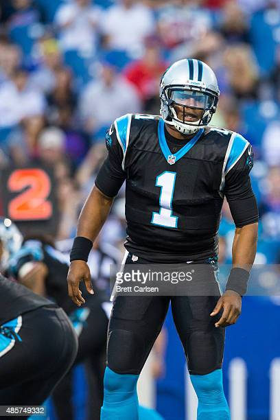 Cam Newton of the Carolina Panthers looks to the sideline for instruction during the game against the Buffalo Bills on August 14 2015 during a...