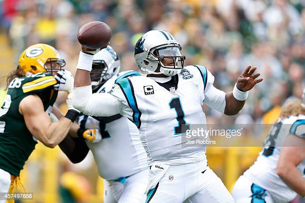 Cam Newton of the Carolina Panthers passes the ball in the first half of the game against the Green Bay Packers at Lambeau Field on October 19 2014...