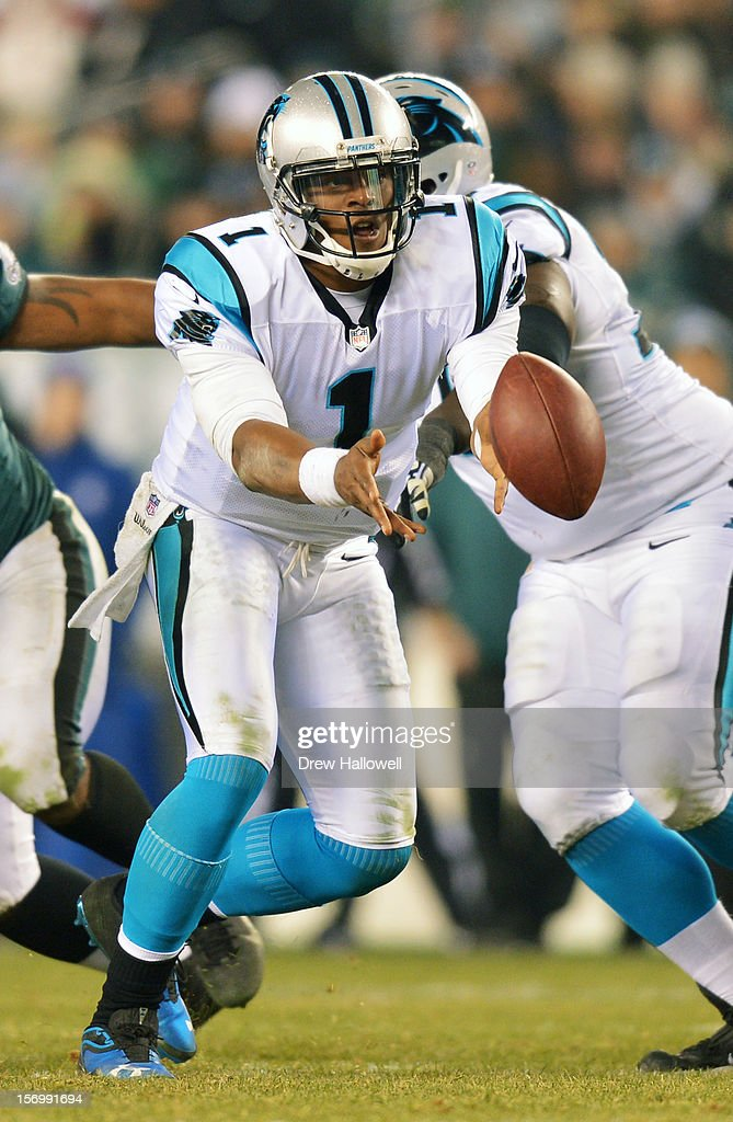 Cam Newton #1 of the Carolina Panthers pitches the ball during the game against the Philadelphia Eagles at Lincoln Financial Field on November 26, 2012 in Philadelphia, Pennsylvania. The Panthers won 30-22.