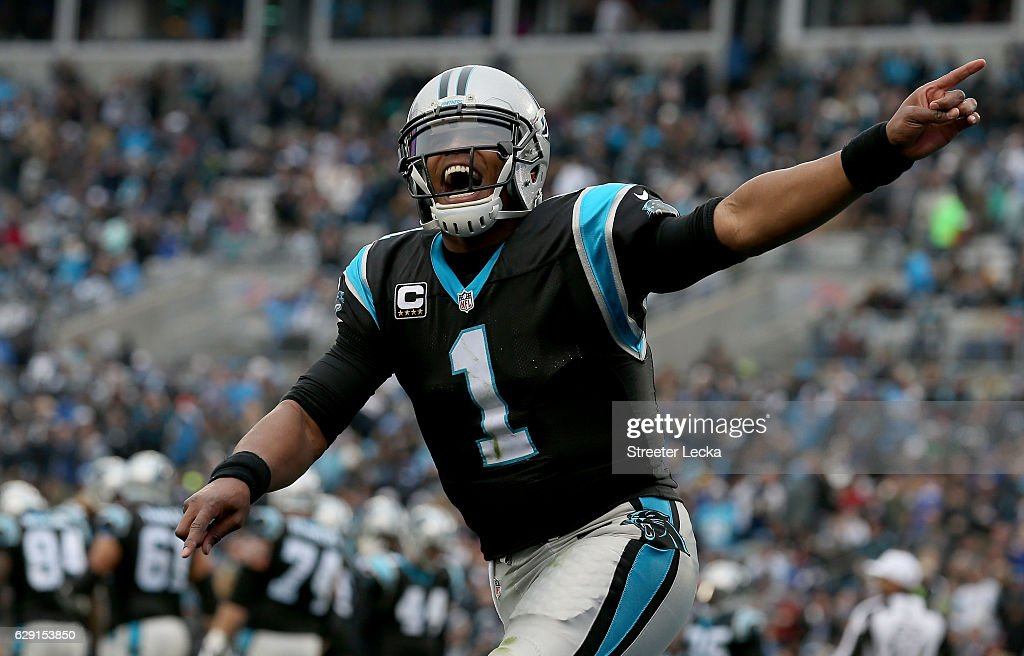 Cam Newton #1 of the Carolina Panthers reacts after a 1st quarter touchdown against the San Diego Chargers during their game at Bank of America Stadium on December 11, 2016 in Charlotte, North Carolina.